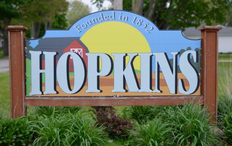 Image of Hopkins Village MI entrance sign